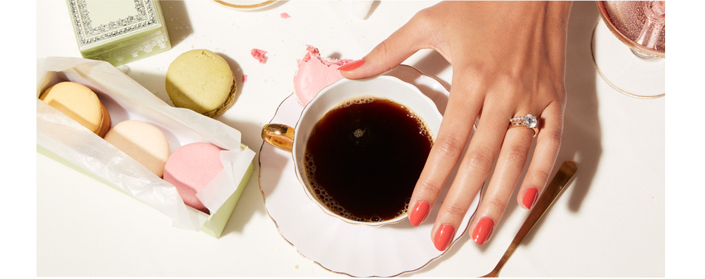 woman with Kleinfeld bridal ring and a cup of coffee at a wedding.