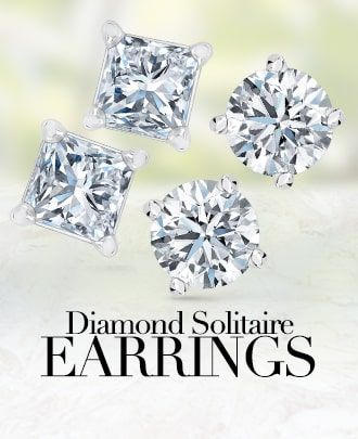 Diamond solitaire earrings.